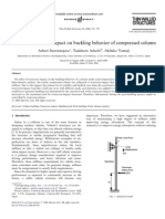 Effect of Transverse Impact on Buckling Behavior of Compressed Column