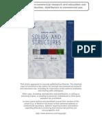 A Coupled Timoshenko Model for Smart Slender Structures