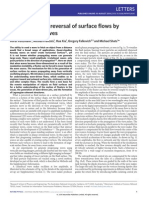Generation and reversal of surface flows by propagating waves