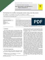 Development of a Nefgfgutron Tomography System Using a Low Flux Reactor