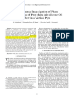 Experimental Investigation of Phase Distributions of Two-phase Air-silicone Oil Flow in a Vertical Pipe