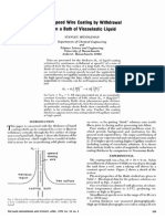 High Speed Wire Coating by Withdrawal From a Bath of Viscoelastic Liquid
