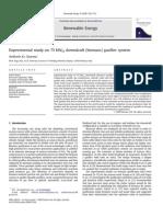 Estudio experimental de un sistema gasificador de biomasa de 75 kWh de flujo descendente