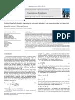 Critical Load of Slender Elastomeric Seismic Isolators