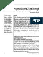 factores asociados a sintomatologia clinica de ansiedad dental en pacientes adultos.pdf
