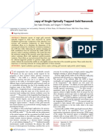 Absorption Spectroscopy of Single Optically Trapped Gold Nanorods