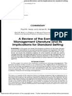 A Review of the Earnings Management Literature and Its Implications for Standard Setting
