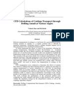 CFD Calculations of Cuttings Transport through Drilling Annuli at Various Angles