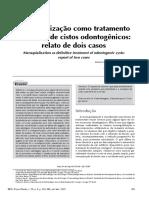 Marsupialização como tratamento definitivo de cistos odontogênicos Relato de dois casos.pdf