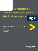 ''Water Shell'' Model for the Dielectric Properties of Hydrated Silica-filled Epoxy Nano-composites