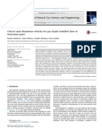 Critical sand deposition velocity for gas-liquid stratified flow in horizontal pipes