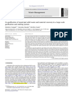Co-gasification of municipal solid waste and material recovery in a large-scale gasification and melting system