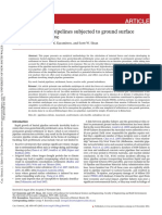Analysis of Buried Pipelines Subjected to Ground Surface Settlement and Heave