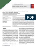 Lu_Heat Transfer Characteristics in a Horizontal Swirling Fluidized Bed