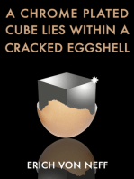A Chrome Plated Cube Lies Within a Cracked Eggshell