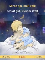 Mirno spi, mali volk - Schlaf gut, kleiner Wolf. Dvojezična otroška knjiga (slovenščina - nemščina)