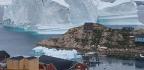 Massive Iceberg Looms Over A Village In Greenland